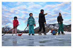 girls vs boys (༺lifemage༻) Tags: winter ice iceskating skating skate hockey outdoor ranch rural bc canada canadian sport fun game play skates sticks helmet sky clouds mountain valley rink kids family lifemage photography canon light sun shadow