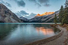 Morning at Bow Lake (Kirk Lougheed) Tags: alberta banff banffnationalpark bowglacier bowglacierfalls bowlake canada canadian canadianrockies canadien crowfootmountain icefieldsparkway mountthompson mtthompson portalpeak alpenglow autumn dawn fall glacier lake landscape mountain nationalpark outdoor shore shoreline sunrise water waterfall