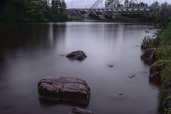Rideau River Rocks (photothiel) Tags: bridge water river memorial rocks long exposure riverside south ottawa conservation area mills rideau barrhaven density chapman neutral cokin vimy nd4 nd2 ontraio