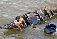 Tonle Sap - Cambodia (jcbkk1956) Tags: boy lake water girl swimming children boat bucket nikon cambodian khmer sister brother canoe siemreap sinking tonlesap punt canbodia