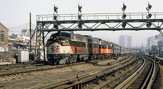 Penn Central operated former New Haven Railroad EDER-5 class EMD FL-9 # 2008 & # 2049 is seen leading a train of New York Central passenger cars on the third rail line at 138th St Bronx, New York City, March 1969, Dan Pope Col