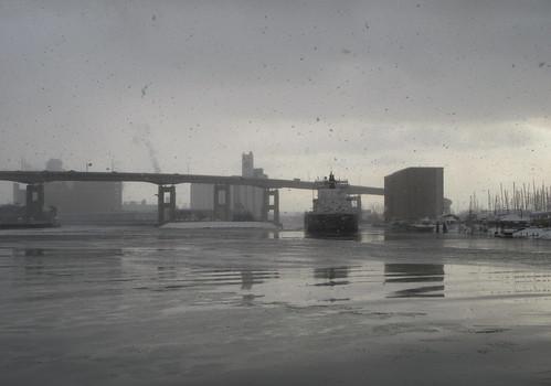 Buffalo Inner Harbor in snowfall, with MV American Mariner