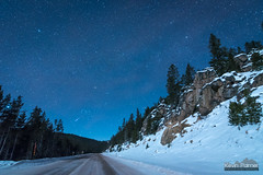 Road to Orion (kevin-palmer) Tags: night sky astronomy astrophotography stars starry moonlight moonlit blue cold frigid winter december early morning sibleylake bighornnationalforest bighornmountains wyoming snow snowy white pine trees highway14 road icy orion cliffs rocks solstice nikond750 tokina1628mmf28