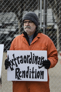 Mike Fiala Holds a Sign in Front of the White House, Protesting Extraordinary Rendition