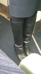 20161208_092334 (ph4eveh) Tags: candid flight attendant black boots tights secy legs woman