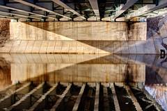 Finding Light and Direction From Below (matthewkaz) Tags: bridge overpass underpass river grandriver water reflection reflections angles triangle light washington washingtonave downtownlansing lansing inghamcounty michigan 2017