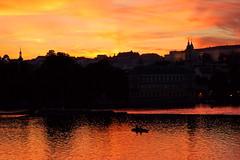 The sunset over the Vltava (Yuri Rapoport) Tags: prague praguecastle pražskýhrad malástrana hradčany czechrepublic thevltavariver night church stvituscathedral