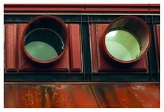 . (Angela Malavenda) Tags: airport lamezia terme detail red eyes metal window rounded green glass calabria