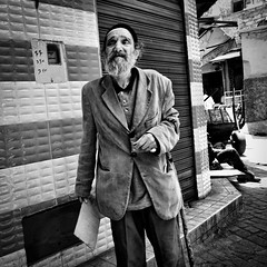 Candid portrait @ Marrakech (PaulHoo) Tags: marrakech morocco monochrome blackandwhite 2016 candid streetcandid streetphotography people portrait medina contrast bw street urban streetlife man men disabled