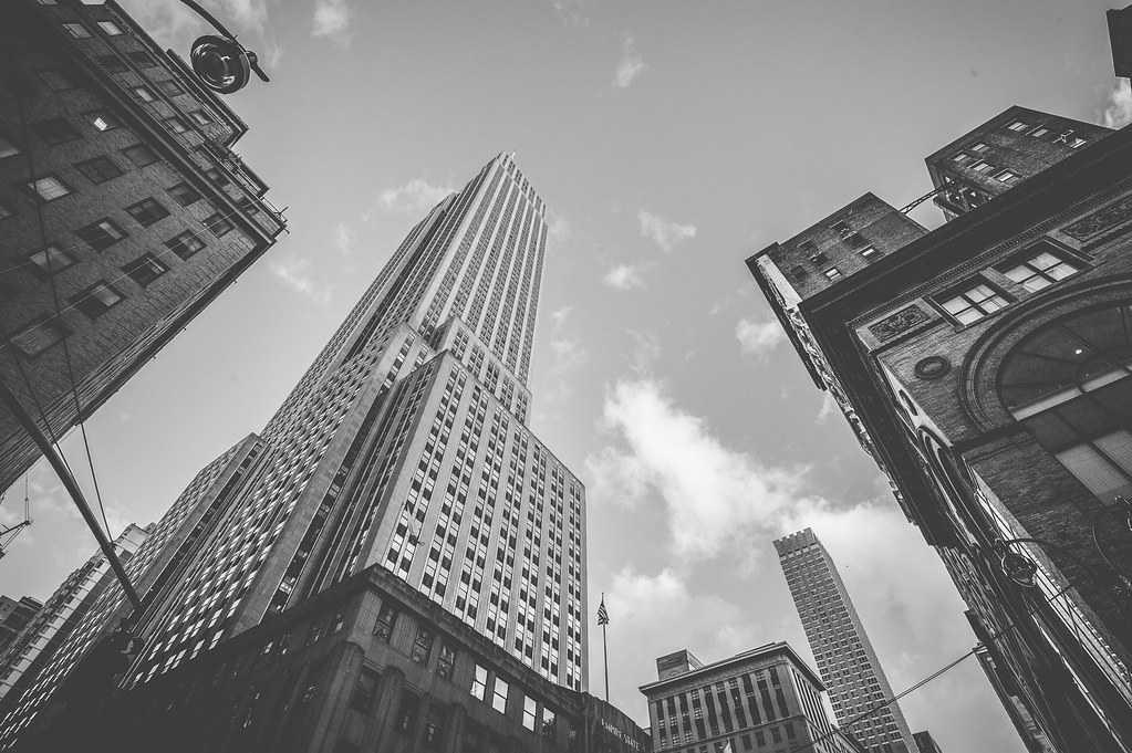 A black and white edit of a vertical view of the Empire State Building in New York City.