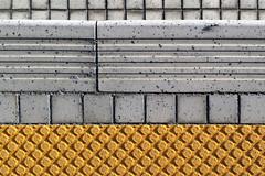 Pedestrian IMG2034 (KWsideB) Tags: ant shapes ground squares rectangles circles yellow tiles mosaic antislip urban