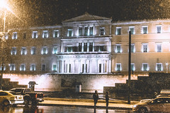 Cure For Misery (Stelios Kotsovilis) Tags: athens cure misery light lights highlight highlights street city urban town downtown snow winter people person architecture sky night europe greece taxi taxis car cars building
