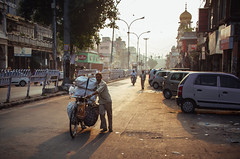 Morning in Delhi (Mathijs Buijs) Tags: man bags loaded bicycle empty street sunrise light new old delhi chandni chowk northern india asia canon eos 7d