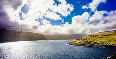 Kvivik - Faroe Islands (@PAkDocK / www.pakdock.com) Tags: 2016 faroe landscape pakdock travel sea nature island clouds cloudscape house ocean roof grass green town village graveyard sunny islands earth outdoors landmark fjord grassland hut planet voigtlander wanderlust faroese streymoy viallage cliff cloud sun ray beam laight sky water