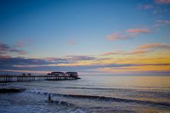 Evening Surf (aljones27) Tags: cromer norfolk coast sea seaside coastal wave waves surf surfer surfing sunset evening beach