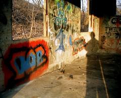 DAR (O Caritas) Tags: railroad blue shadow portrait people orange selfportrait me yellow self graffiti dar twine lateafternoon abandonedbuilding ocaritas