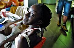 anonymous smile ( Tatiana Cardeal) Tags: 2005 brazil portrait woman brasil photojournalism documentary portoalegre social tatianacardeal brsil worldsocialforum eos100 documentaire portoalegrecity documentario socialmovement frumsocialmundial wsfwomen