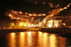 Nightswimming (reNET) Tags: sea town night lights reflects orange cudillero asturias spain espaa unfound eps1 eps2