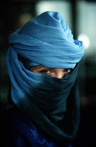 a muslim woman hidden by a veil