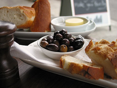 Olives and bread - by Dey