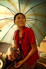 burmese woman under an umbrella - portrait woman umbrella myanmar phitar burmese under