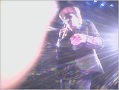 Bono. 2005-04-01. (musique nonstop) Tags: u2 livemusic music concert cameraphone bono light cowboyhat hat arrowheadpond singing anaheim1