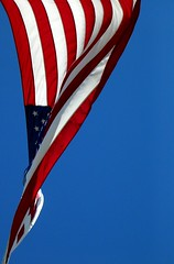 Flag In Wind #1 (O Caritas) Tags: blue red sky white flag windy flags lookingup starsandstripes redwhiteblue flaginwind shutterstock