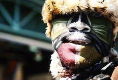 Catman peering (Lil [Kristen Elsby]) Tags: africa portrait man topv2222 southafrica costume topf75 teeth makeup fangs facepaint performer johannesburg catman joburg fakefur