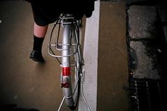 schoolgirl (yi) Tags: japan 2005 kyoto lomo lca bike bicycle schoolgirl japaneseschoolgirl loafers socks