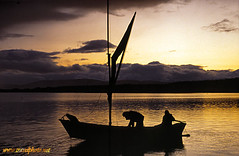 Fishing Loch Morlich (laurenz) Tags: park uk travel light sunset people 15fav lake color colour nature colors topv111 catchycolors landscape photography licht scotland boat fishing colorful europe colours unitedkingdom availablelight united ships kingdom escocia colores national fisher loch 525fav farbe 110fav farbig couleur bunt available farben laurenz cairngorm cairngorms morlich travelphotography farbfotos coloroso schottisch outstandingsunrises lbobke