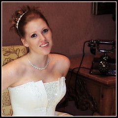 smile (TexasValerie) Tags: wedding portrait woman sepia bride phone melody bling weddingdress bridal bridalportrait