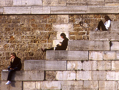 Evening by the Seine (Karl O'Brien) Tags: red paris france brick stone seine reading evening three sitting dusk side steps relaxing books thinking sideways triio diagnoal