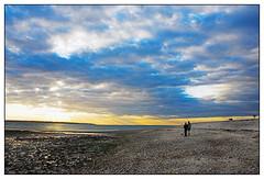 sky gazers (ZekiZeki) Tags: light sky sun clouds couple watching pebbles rays southampton admiring gosport stokesbay