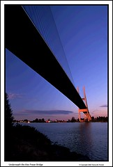 Underneath the Alex Fraser Bridge (Mrs. Terry) Tags: blue architecture reflections framed bridges sunsets natureslight instantfave vancouverbccanada flickrific copyright2006byteresamforrest photosbyterry picswithframes