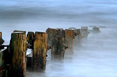 Going under (Ray Byrne) Tags: uk longexposure sea england beach water canon geotagged 350d coast bravo north northumberland shore alnmouth northern northeast groyne ybp nozombies geo:lat=5540169588 geo:lon=159183802 raybyrne nomist byrneout ostrellina
