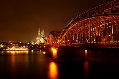 Cologne ({ Planet Adventure }) Tags: travel bridge favorite 20d beautiful arquitetura night germany eos interestingness amazing cool holidays europe flickr nightshot postcard famous explorer great landmarks railway ab adventure backpacking 100views winner stunning planet iwasthere 400views 300views 200views 500views tagging canoneos atnight allrightsreserved 600views arquitecture railwaybridge myfaves germanytrip havingfun aroundtheworld onflickr copyright visittheworld travelphotos postcardshot 200mostinteresting facinating traveltheworld travelphotographs 18122005 canonphotography 87points alwaysbecapturing worldtraveller planetadventure amomentcapgrp lovephotography theworldthroughmyeyes kologne spectnight beautyissimple peoplesfavourites theworlthroughmyeyes tedesafio ivebeenthere challengeyouwinner randomgermany selectedasfave peopleseemtolike supperb imveryproudof flickriscool loveyourphotos theworldthroughmylenses greatcaptures shotingtheworld by{planetadventure} byalessandrobehling icanon icancanon canonrocks selftaughtphotographer phographyisart travellingisfun copyright20002006alessandroabehling allinteresting setfrontimage allgermany visitgermany justgermany greatgermany