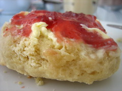 Scone with butter, clotted cream and jam