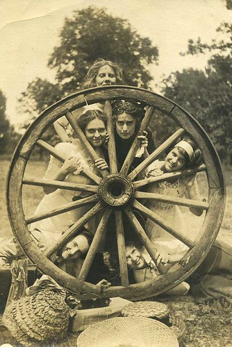 Six Girls Behind the Wagon Wheel