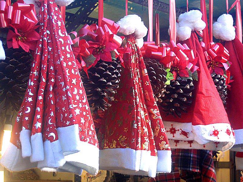 Santa's hats at Sta Llucia Xmas Market.Barcelona. Catalunya.December 2005