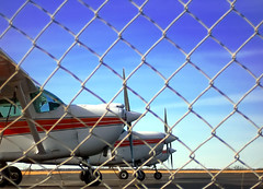 the fenced-in blue yonder (cosmoknot) Tags: airplane blue airport propeller fence runway deleteme deleteme2 deleteme3 deleteme4 deleteme5 deleteme6 deleteme7 deleteme8 deleteme9 deleteme10