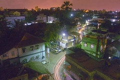 Mumbai: The village within... (Anindo Ghosh) Tags: longexposure nightphotography travel india skyline wow geotagged lowlight topv555 topv333 dusk availablelight indian apex citylights bombay maharashtra mumbai bandra extendedexposure continuum traffictrails anindo 1mostinteresting topv25 555v5f bulbmode 666v6f chapelroad mumbaiindia bombayindia geo:lat=19052828 geo:lon=72828578 anindoghosh nightshotcontest2