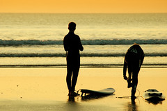 Getting ready (Xavier Donat) Tags: family sea beach silhouette backlight surf waves d70 surfer board bretagne explore tamron 142 baptiste 70210mm 08012006 explored topphotoblog