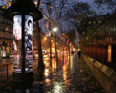 Rainy Night in Paris, Blvd. St. Germain (Bill in DC) Tags: 15fav paris france 2004 topf25 topv111 night topf50 topv555 canon20d topv444 2550fav 50100fav fv10 topv666 eos20d 5eme bestdigitalphotography views500 views700 views600 views400 favs40 favs45 favorites50 favorites60 lovephotography bluelist spectnight 30faves30comments300views