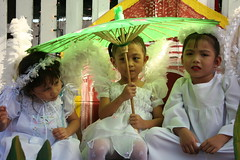 panag-ambit (Farl) Tags: girls color festival kids umbrella children wings catholic faith philippines religion culture angels parasol cebu filipino procession tradition cherubim cherubs sinulog sinulog2006 cebusugbo