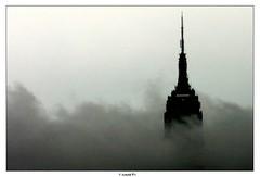 SkyScrapper (Arnold Pouteau's) Tags: nyc newyorkcity sky bw newyork clouds manhattan 2006 esb tribeca outsidethewindow f25 january06