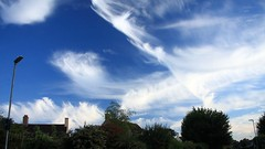 Cirrus Display (innpictime  ) Tags: sky clouds skyscape evening rooftops streetlamps bluesky cambridgeshire cloudformation cirrus orchardroad melbourn summersky southcambs 520841360022041