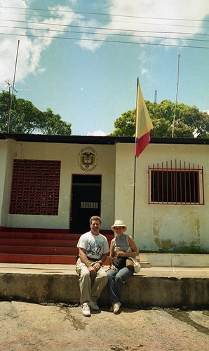 Will and Deb pose for a photo in front of the Police Building, Casuarito, Columbia