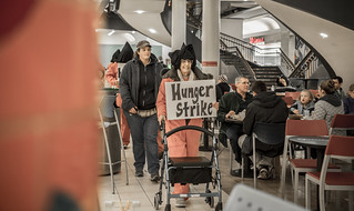 Eve Soldinger Holds a Sign During an Anti-Torture Demonstration in Union Station
