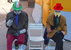 The invisible men cometh (stephenweir) Tags: invisiblemen buskers funnymen romebuskers outsidethecolosseum coliseum buskertrends dummies europeanbuskertrends greenhat streettheatre redhat italianbuskers italy romedowntown roma chairsonstreet dummy manequin smartdummies movingmannequins