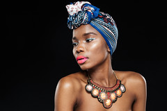 Attractive african woman looking away (Ksu Zviagin) Tags: africa afro american nigerian isolated clothing gorgeous model black guinean clothes blue fulani senegalese culture south head studio veil people senegal headdress female fashion fabric portrait smile young hijab girl african face woman makeup beauty headscarf islamic teenager style beautiful background teen scarf accessories necklace attractive
